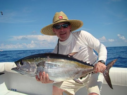 A person holding a fish - Tuna