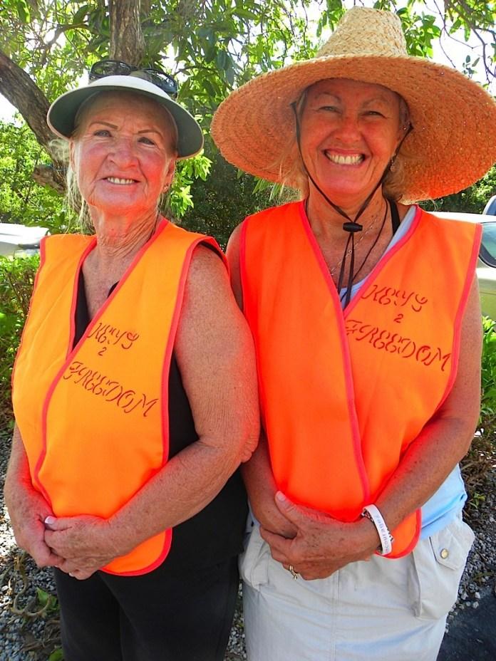 A group of people wearing orange hat - Headgear