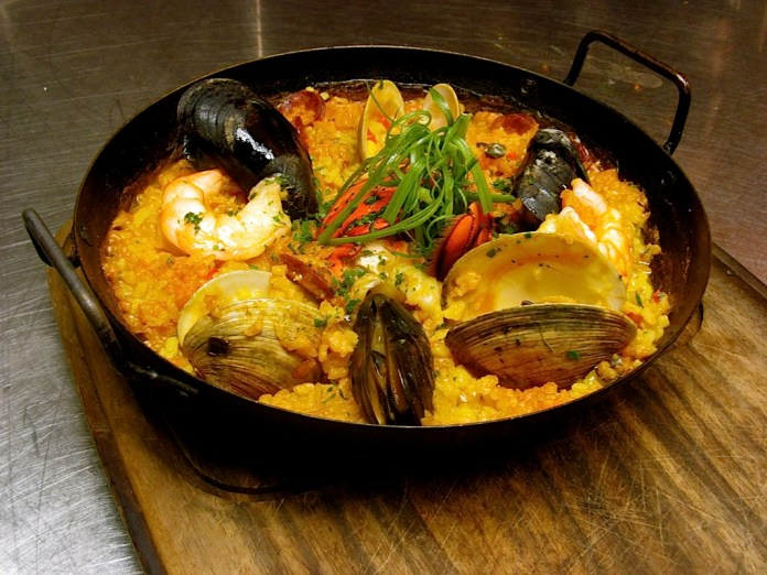The paella with shrimp and chorizo is one of the most popular dishes at Hot Tin Roof.