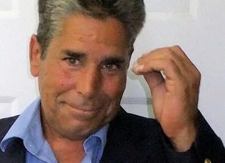 A man looking at the camera - John L. Guerra
