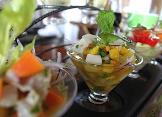A close up of a bowl of salad - Ceviche