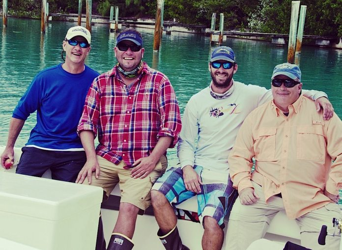 Team Marathon in the Sailfy Tournament — Capt. Mike Biffel, Capt. Ariel Medero, Mate Ace Hunter and Jim Reed — braved foul weather to raise some sails.