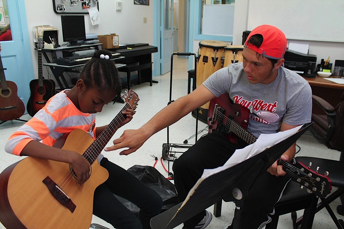 Children In Bahama Village Unwrap The Gift Of Song Young Music