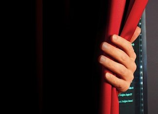 A person in a red shirt - Curtain