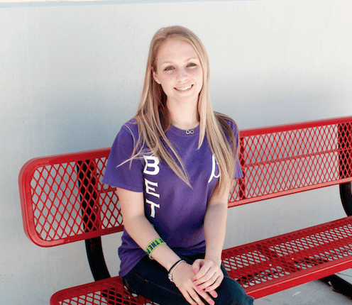 #News: Student of the Week (Angela Martin, Senior) - A woman smiling for the camera - Shoe