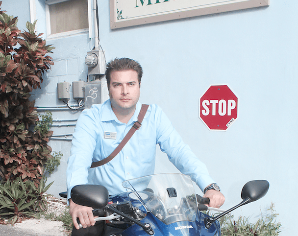 #RealEstate: The real deal on buying in Key West - A person standing in front of a motorcycle - Product