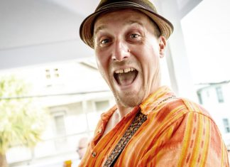 Sunset Social unites again – The event raises money for Key West Wildlife Center - A man wearing a hat -