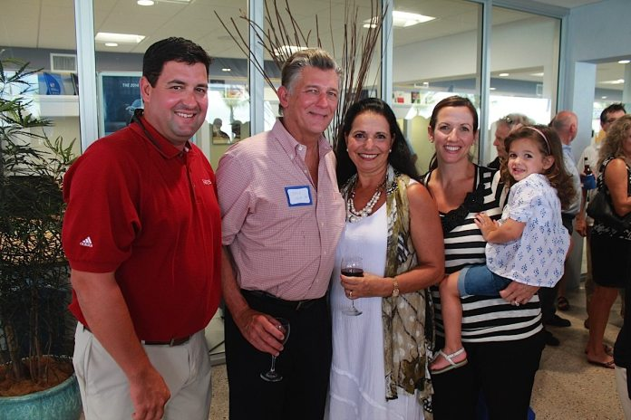 The 'new' Niles –100 plus attend Chamber After Hours - A group of people posing for a photo - Social group