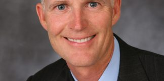 #News: Florida Governor Rick Scott to visit Marathon on Friday - Rick Scott wearing a suit and tie - Rick Scott