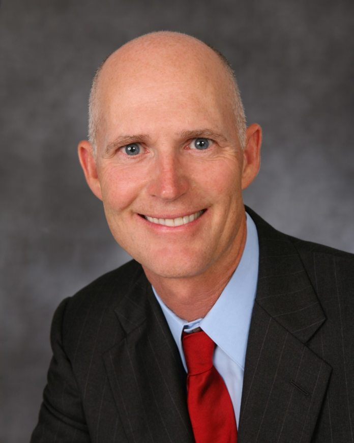#News: Florida Governor Rick Scott to visit Marathon on Friday - Rick Scott wearing a suit and tie - Rick Scott