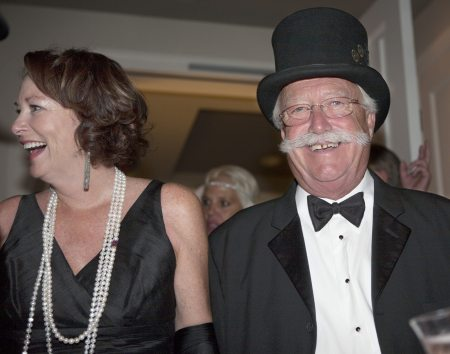 Stan Coffman in the top hat and lady companion embody Gatsby style.