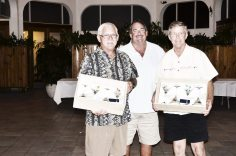 Team champ anglers Jim Smith and Charlie Miller celebrate 13 fish caught with Capt. Richard Keating.