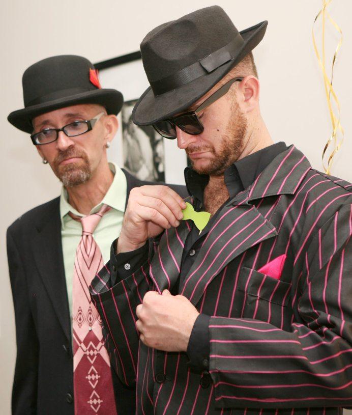 Kenee Tucker and Lucas Rozene check their look.