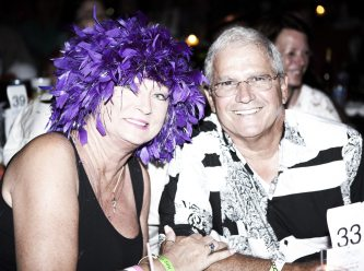 Mayor Craig Cates and his wife Cheryl sit stage-side at the Headdress Ball. Entertainment included Howard Livingston of the Mile Marker 24 Band.