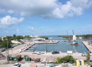 #News: Hyatt to be complete by mid-December - A boat is docked next to a body of water - Marina