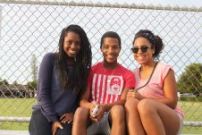 Takara McKnight, left, shares a bleacher with her brother Xavier McKnight and friend Aliyah Sims. Xavier and Aliyah recently departed for their freshman year at the American Musical and Dramatic Academy in New York City.