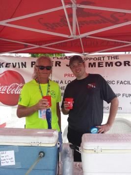 David Cooper and Alex Lukas volunteer at the event.