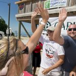 #Events: Marathon Residents Win Stone Crab Eating Contest - A man holding a sign - Hawks Cay Boulevard