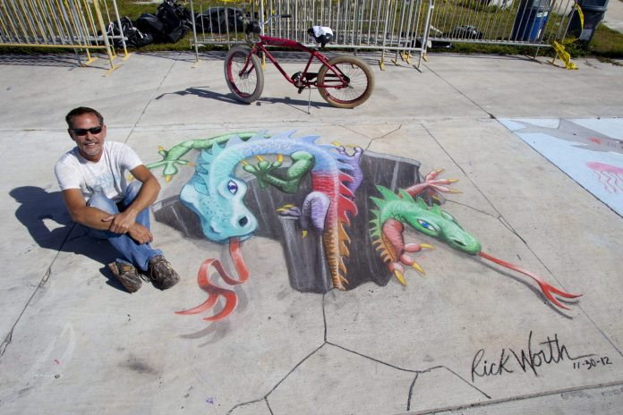 #Events: Key West Chalk Festival - A person sitting on a bench - Street art