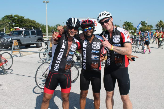 #SeenAroundTown: Athletes ride to battle AIDS - A group of people posing for the camera - Road Bike