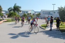 #SeenAroundTown: Athletes ride to battle AIDS - A group of people riding on the back of a bicycle - Road Bike
