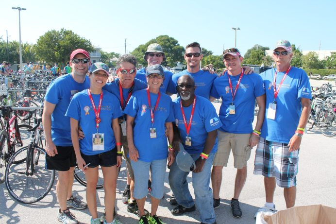 #SeenAroundTown: Athletes ride to battle AIDS - A group of people posing for a photo - Car