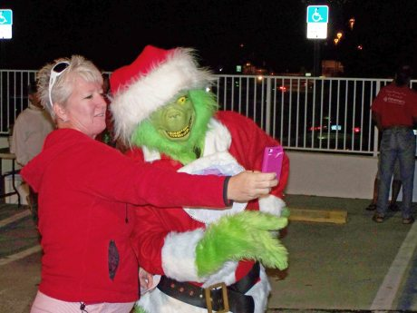 Grinch selfie! Jody Randle, OneBlood donor recruiter, snaps a shot with The Man in Green, otherwise known as Monroe County Sheriff Lou Caputo.