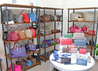 #Shop: New handbag store carries all designs - A room filled with furniture and a table - Handbag