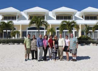 #News: Glunz adds 8 beachfront villas - A group of people standing in front of a building - Glunz Ocean Beach Hotel & Resort