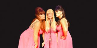 #See: Holiday doo-wop with The Fabulous Spectrelles - A person wearing a dress - Ann McKee