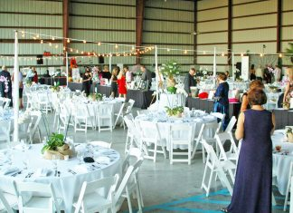 Sweetheart Ball set for Feb. 7 - A group of people sitting at a table - Wedding reception