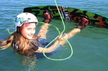 Ria Rodriguez, 13, tries her hand at wakeboarding via cable. She does great!