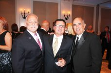 City Commissioner Tony Yaniz, Utility Board member Barry Barroso and County Administrator Roman Gastesi attend the annual event.