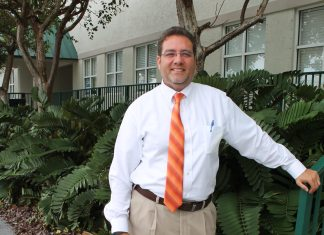 #News: Sam Kaufman to run for Rossi's seat in Key West Election Oct. 6 - A man wearing a suit and tie standing in front of a building - The Law Offices of Samuel J. Kaufman, P.A.