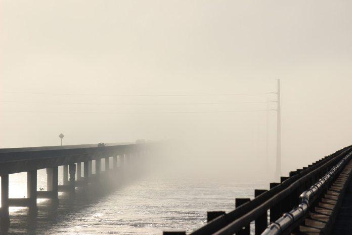 Rare fog envelops Keys, lasts two days - A long bridge over a body of water - Fog