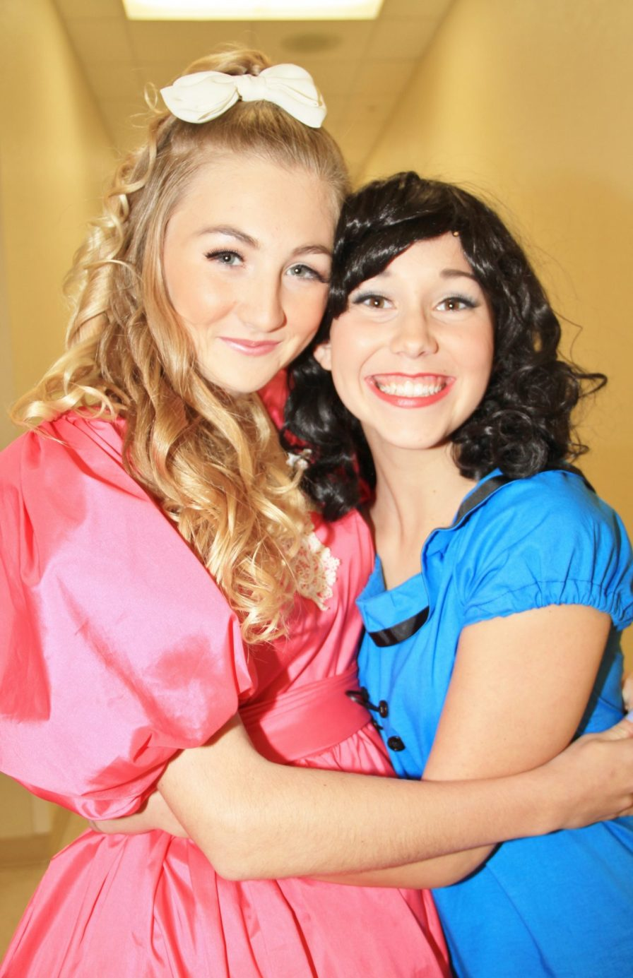 Sally Brown and Lucy Van Pelt, also known as Ariana Patterson and Claire McCarthy give each other a good luck hug before the show starts.