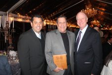 George Galvan presents long-time friend Michael Knowles of the Double Tree Grand Key Resort with the award for the Key West General Manager of the Year. The two were joined by Robert Spottswood.