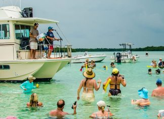 Island Grass Music Fest benefits Habitat - A group of people on a boat in the water - Snipe Point