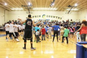 At half-time, the teams invite the crowd onto the court to dance the cha-cha slide.