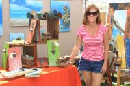 More than 200 vendors sell wares at the event. Artisan Debbi Thompson of Keys Boat Furniture in Big Pine Key shows off some of her reclaimed wood artwork.