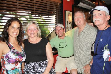 Letisia Powell, left, with Kathy and Bobby Menendez, Chris Carrico and John Welsh gather for a photo. Welsh and Menendez, former Key West High School principals, guest bartend at the event