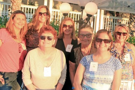Lauren Carrier, left, Lynda Castello, Missi Grund, Wendy Niven, Kathy Felger, Karen Snyder and Cheryl volunteer to welcome supporters to the event.
