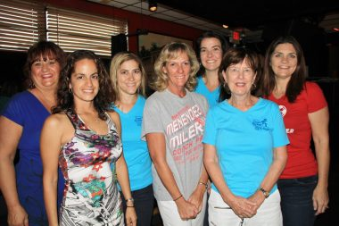Rotary volunteers Joyce Benavides, Letisia Powell, Megan Wise, Cynthia Setzer, Holly Elomina, Cheryl Sargent, and Neecie Scull dress the Bottle Cap with 50/50 raffles and silent auctions opportunities.