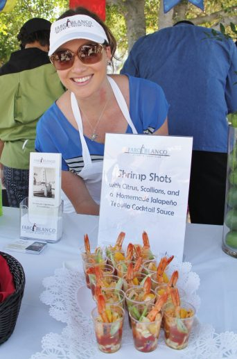 Caitlyn Rogers of Lighthouse Grill shows off the shrimp shots, tangy little shooters that were a crowd favorite and winner of best appetizer.