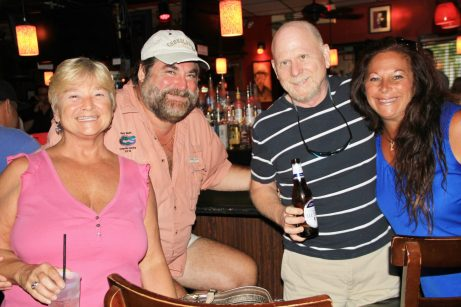 JC, left, and John Gallagher, Roy Hagberg and Chrissy Gallagher support Rotary with tips.