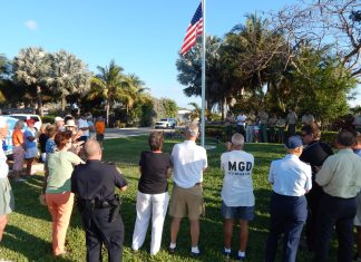 Scout responsible for new flagpole – Ben Ryder organizes project at entrance to Key Colony Beach - A group of people standing in the grass - Tree