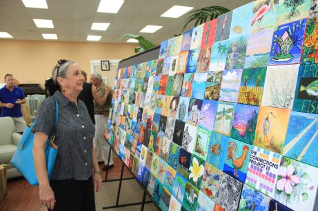 Cathy Russ admires the art work.