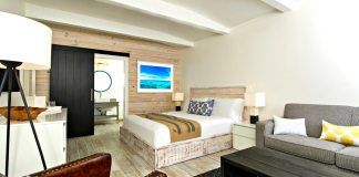 The Gates boasts flair, innovation - A living room filled with furniture and a flat screen tv - The Gates Hotel Key West