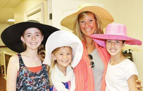 Fishermen's Hospital Foundation Executive Director Kim Gregory — with Gracyn, Finley, and Camryn — pick out the perfect hats to decorate.