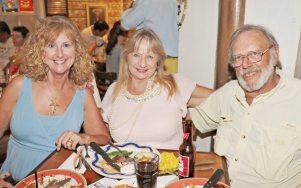 LaReta Morrison, Karen Hirst, and Drew Dzykewicz are constants at Howard's events.